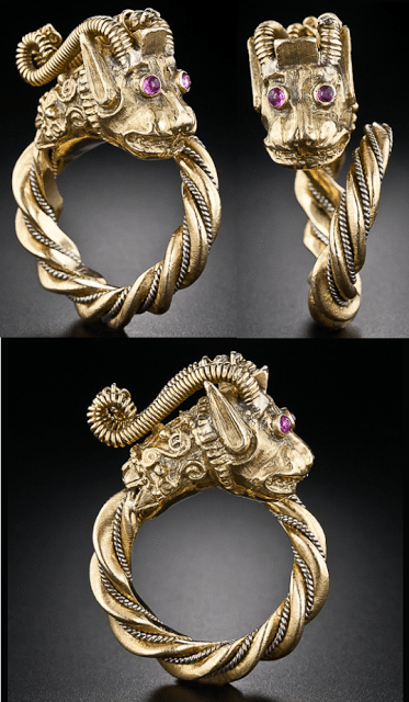Vintage gold and ruby dragon ring in 18k gold. Via Diamonds in the Library.