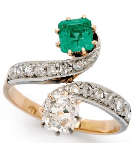 Antique ring featuring one old mine-cut diamond (approx 0.85 carat) and an emerald-cut emerald (approx 0.60 carat) in a moi-and-toi crossover design. Set in yellow gold and platinum, circa 1895.