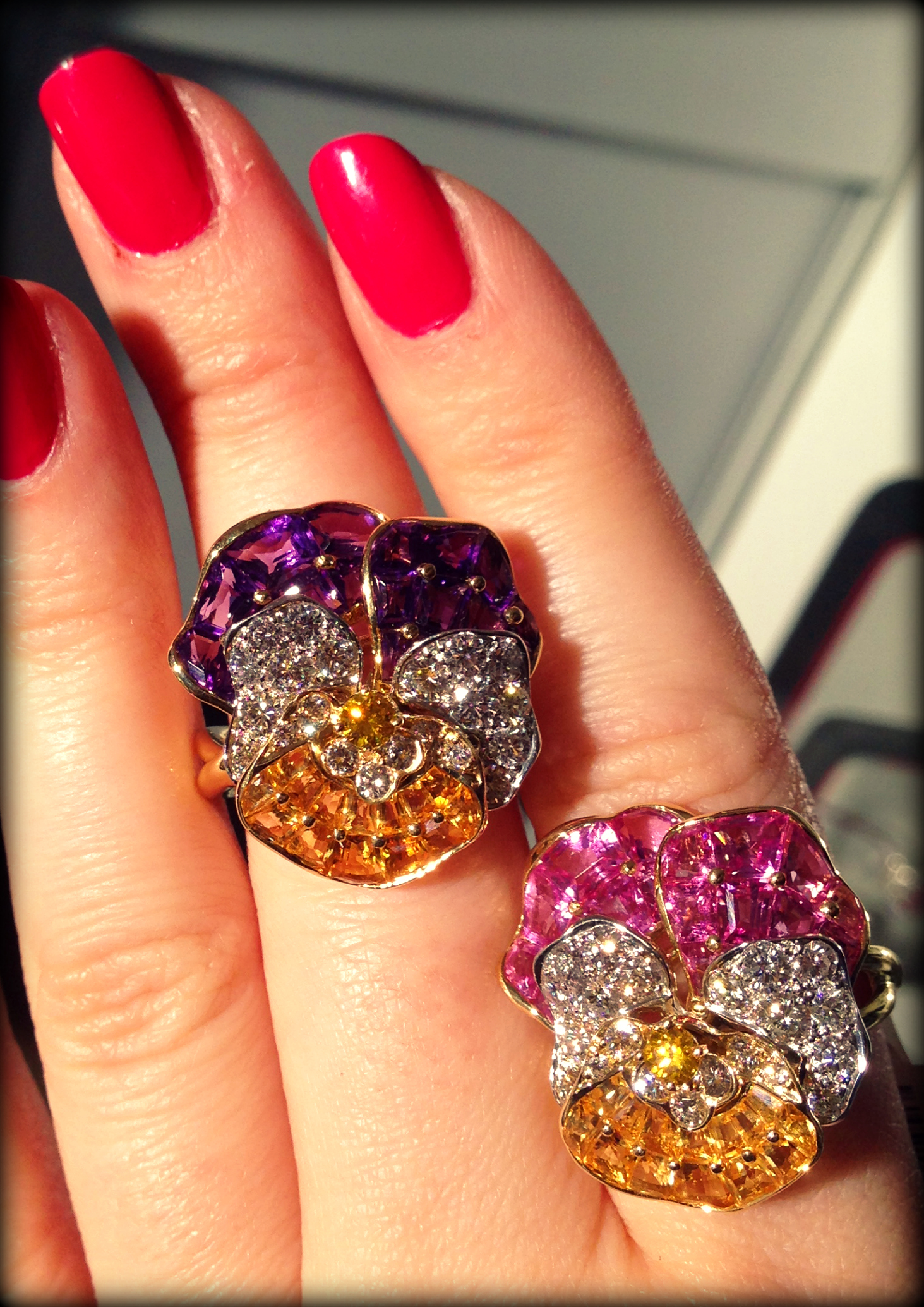 Two iconic Oscar Heyman gemstone and diamond pansy rings. Via Diamonds in the Library.
