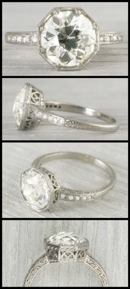 2.3 carat antique Art Deco engagement ring with sparkling side stones, a filigree openwork gallery, and engraved details. Circa 1920. Via Diamonds in the Library.