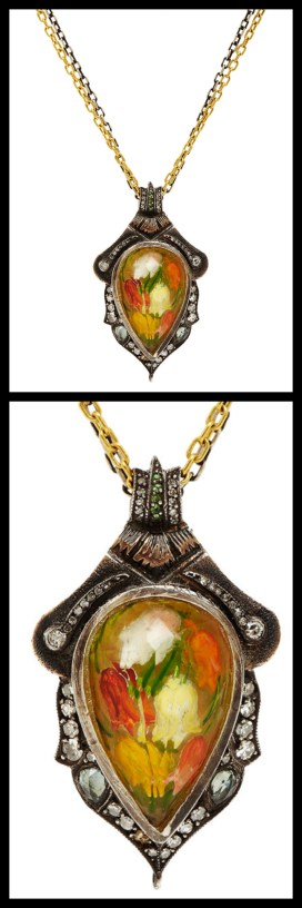 Sevan Biçakçi pendant with intaglio-carved tulips encased within a faceted citrine. The citrine is surrounded by sapphires and white rose cut and black pave diamonds on a scalloped frame. The pendant hangs from 24k gold and oxidized silver chains. Via Diamonds in the Library.