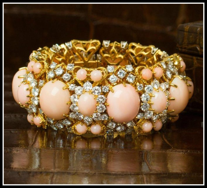A gold, coral, and diamond bracelet. Via Diamonds in the Library.