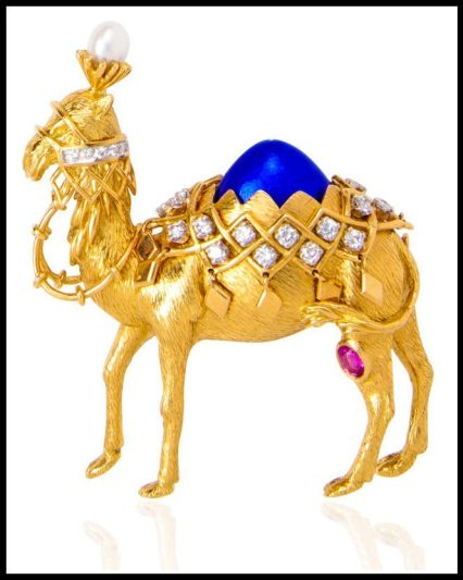 Gold, enamel, diamond and pink sapphire camel brooch by Jean Schlumberger for Tiffany & Co. Via Diamonds in the Library.