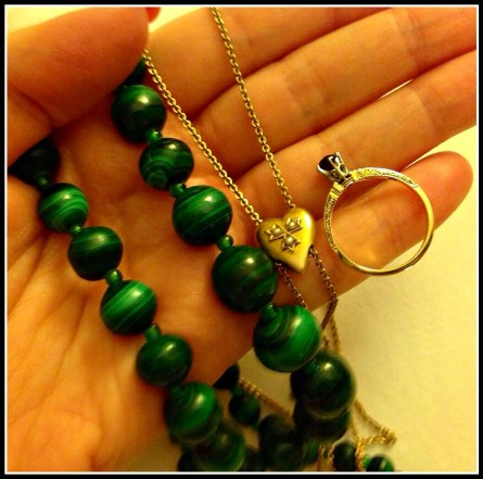 My haul from Scott Antique Market: vintage malachite bead necklace, a long double-stranded rose gold and seed pearl Victorian necklace, and a turn-of-the-century engraved gold and garnet ring. Via Diamonds in the Library.