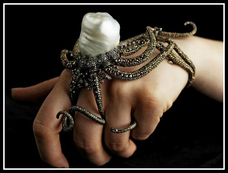 Octopus cuff ring by Sevan Bıçakçı. Multi-colored diamonds, seed pearls, and one South Sea baroque pearl set in 24 karat gold. Via Diamonds in the Library,