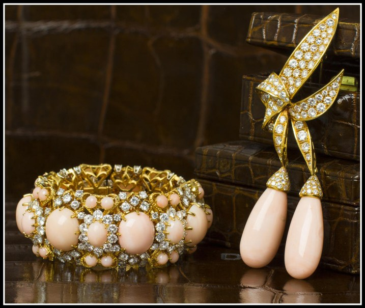 Two pieces of gold, coral, and diamond jewelry: a bracelet and a pendant that converts into a brooch. Via Diamonds in the Library.