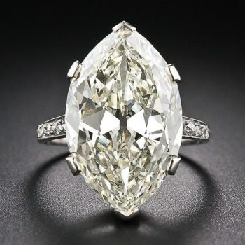 "Antique engagement ring centering a faint yellow 9.55 carat ""moval"" diamond. Via Diamonds in the Library."