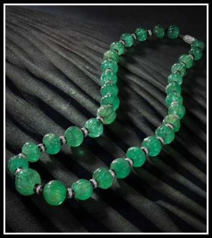 Art Deco Cartier emerald carved bead necklace with onyx, and diamonds. Circa 1925. Via Diamonds in the Library.