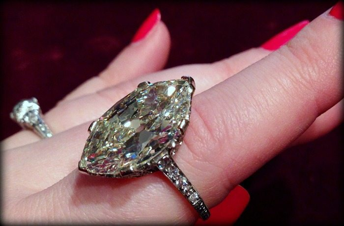 Antique engagement ring centering a faint yellow 9.55 carat moval diamond. Via Diamonds in the Library.