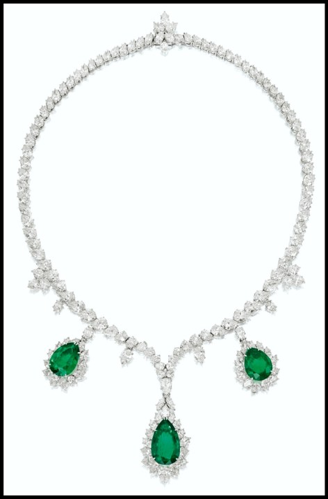 Harry Winston platinum and white gold necklace with pear-shaped emeralds weighing 10.61, 8.30 and 7.02 carats. The emeralds are wreathed in marquise- and pear-shaped diamonds and hang from a necklace set with many more pear- and marquise-shaped diamonds. Total diamond weight: 32 carats. Via Diamonds in the Library.