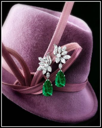 Harry Winston emerald and diamond earrings with 14 carats of diamonds and two emeralds weighing 16.57 and 14.58 carats. Via Diamonds in the Library.