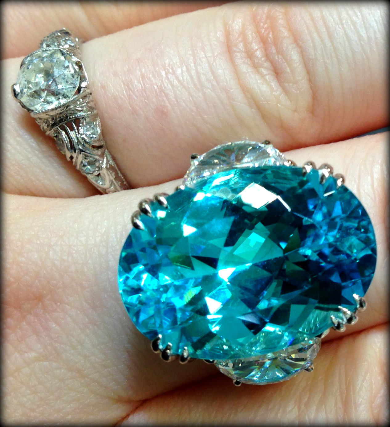 Paraiba tourmaline and diamond ring by JB Star. Via Diamonds in the Library.