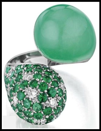 Margherita Burgener crossover ring with a carved chrysoprase, pavé-set diamonds, and tsavorites in white gold. Via Diamonds in the Library.