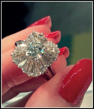 Antique 1930's ballerina diamond engagement ring. Via Diamonds in the Library.
