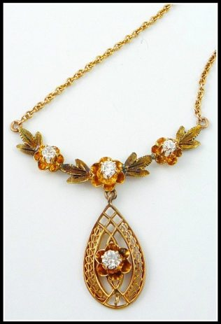 10K Antique Victorian European Cut Diamond Pendant Necklace Lavaliere. Via Diamonds in the Library's jewelry gift guide.