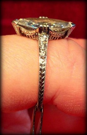 Side view: 1.41 carat Art Deco marquise diamond engagement ring. Via Diamonds in the Library.