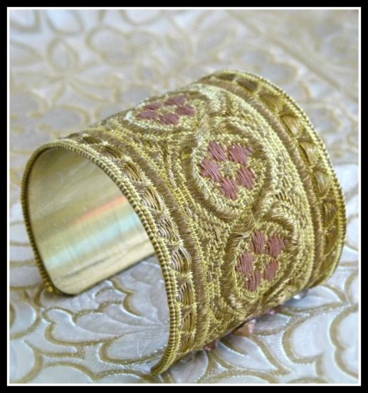 One of a kind cuff bracelet made from antique French silk ribbon woven with real gold thread. Via Diamonds in the Library.