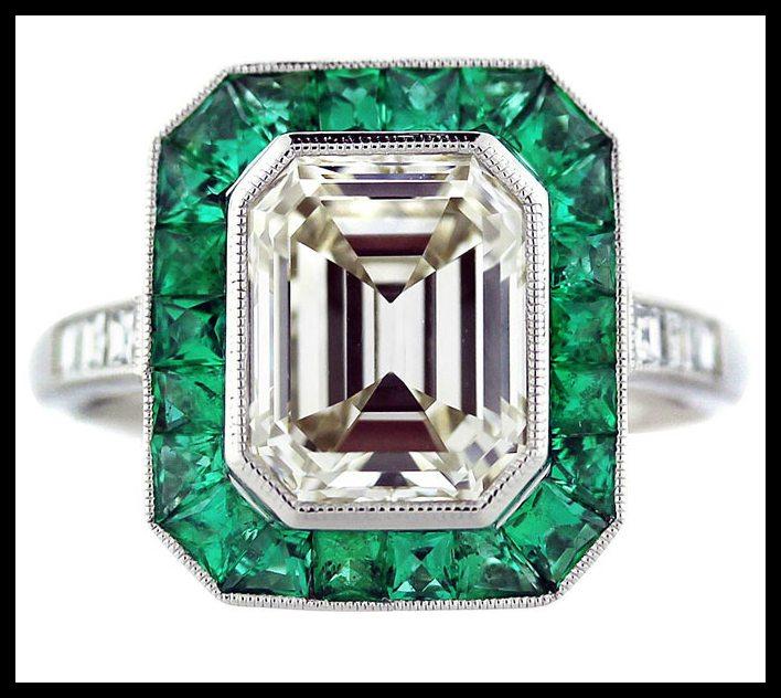 Emerald and emerald cut diamond ring in platinum. Center stone is a 2.5 emerald cut diamond, K color, VS1 clarity. Via Diamonds in the Library.