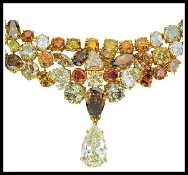 Detail: A natural fancy colored diamond necklace comprised of 117.42 carats of fancy colored diamonds and suspending an 8.5 carat diamond drop. Via Diamonds in the Library.