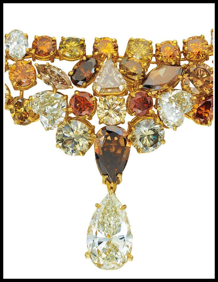 Center detail: A natural fancy colored diamond necklace comprised of 117.42 carats of fancy colored diamonds and suspending an 8.5 carat diamond drop. Via Diamonds in the Library.