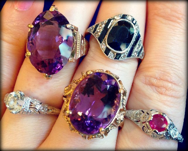 A handful of gemstone rings - Art Deco, retro, and contemporary; sapphires, amethysts, and a ruby - at The Antique Guild. Via Diamonds in the Library.