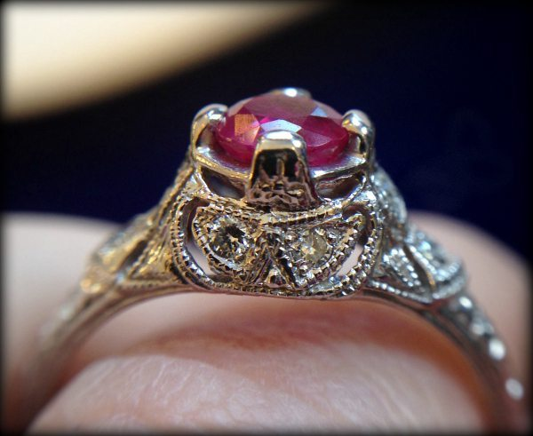 Antique inspired ruby and filigree ring. Via Diamonds in the Library.