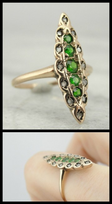 Antique Victorian demantoid garnet and diamond navette ring. Via Diamonds in the Library.