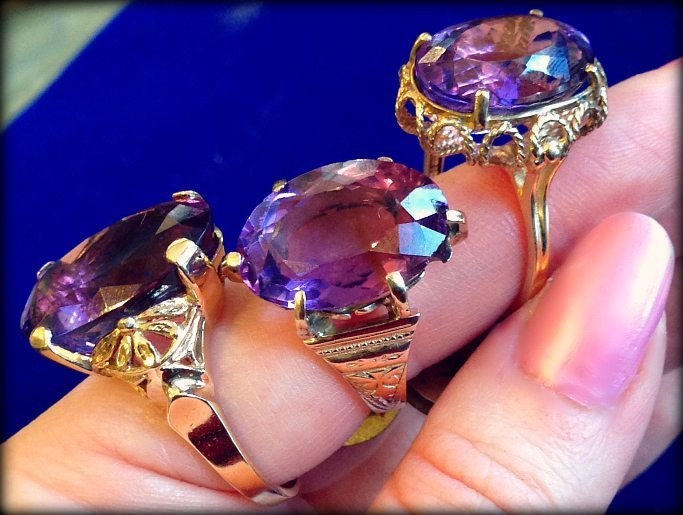 Three amethyst and gold rings. Via Diamonds in the Library.