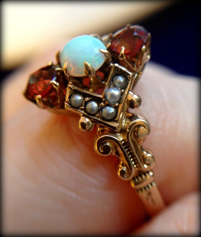 Victorian garnet, opal, and seed pearl ring. Via Diamonds in the Library.