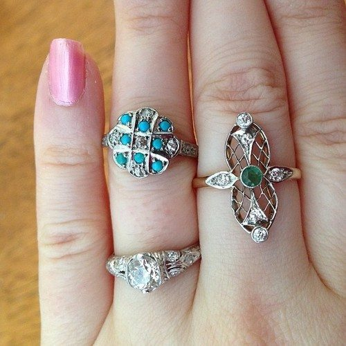 Antique emerald, diamond, and turquoise rings. Via Diamonds in the Library.