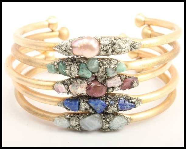 Cuff bracelet with gemstones, at Catbird. Comes in pearl, raw emerald, pink tourmaline, lapis lazuli, or aquamarine. Via Diamonds in the Library.