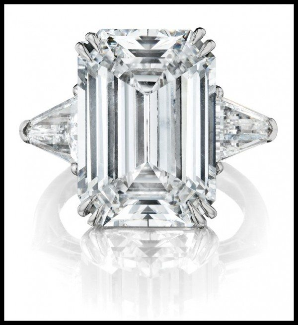 10 carat diamond engagement ring with trap-cut diamond shoulders, centering a 10.54 carat, D color, VVS2 clarity rectangular cut stone. Via Diamonds in the Library.