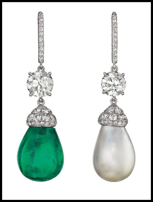 Asymmetrical emerald, pearl, and diamond drop earrings. Via Diamonds in the Library.