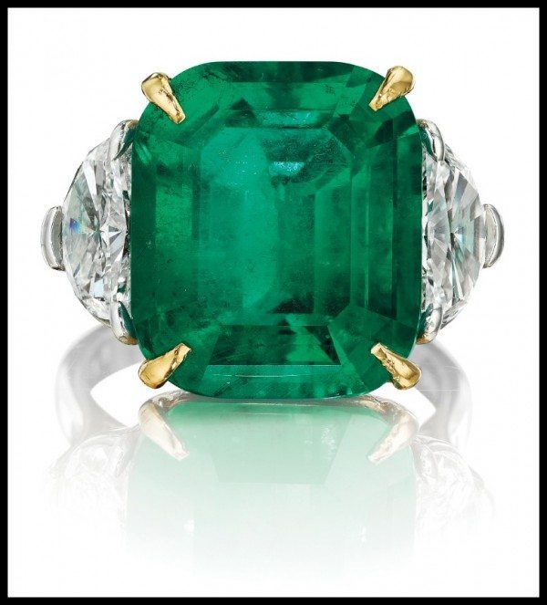 Colombian emerald and diamond ring with an 11.20 carat cushion-cut emerald framed by half-moon diamonds and set in yellow gold and platinum. Via Diamonds in the Library.
