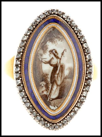 Georgian gold and diamond navette ring shows a shepherdess carving her lover's initials in a tree. Via Diamonds in the Library.