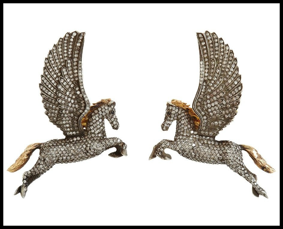 Pegasus earrings by Sevan Bıçakçı: oxidized silver with 5.29 carats of black and white diamonds and rose gold accents. The wings open to reveal an interior of 24 karat gold. Via Diamonds in the Library.