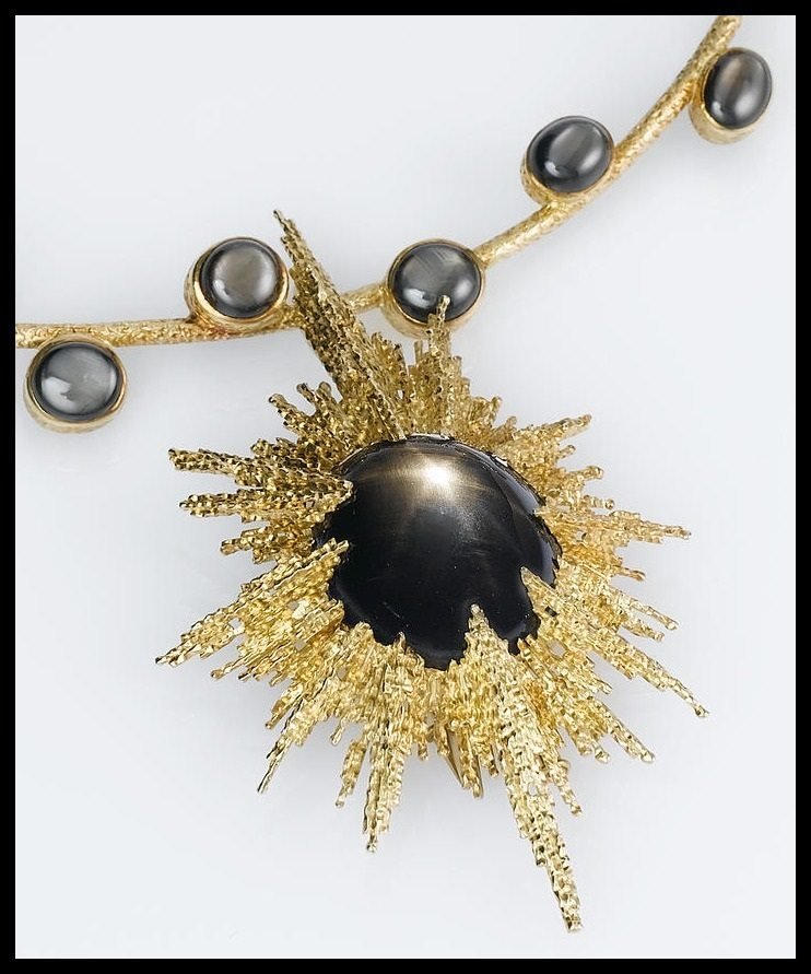 Cabochon black star sapphire and gold necklace by Andrew Grima, circa 1975.