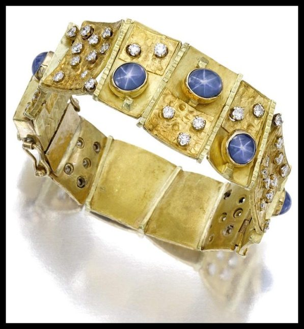 Gold link bracelet with diamonds and star sapphires by Mary Kretsinger.