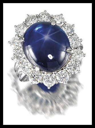 Star sapphire and diamond cluster ring