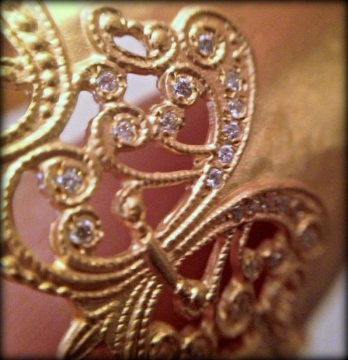 Detail of gold and diamond cuff bracelet by H.Weiss.