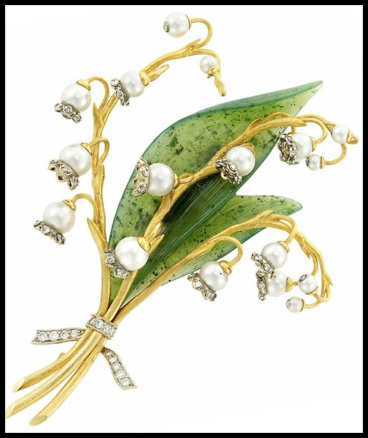 Gold, carved nephrite, pearl, and diamond Lily of the Valley brooch by Zadora.