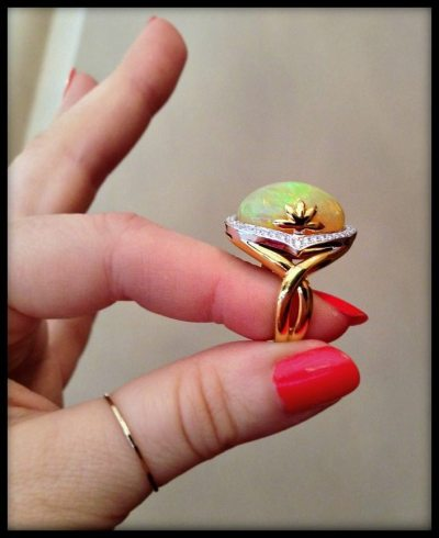 Spark Creations' opal ring diamond diamond accents in 18k two tone gold.