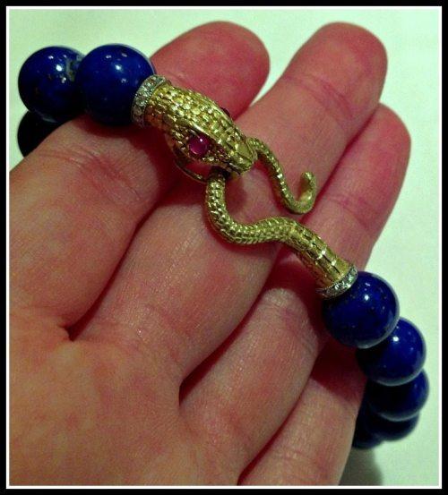 Anthony Lent snake bracelet in lapis, gold, rubies, and diamonds.