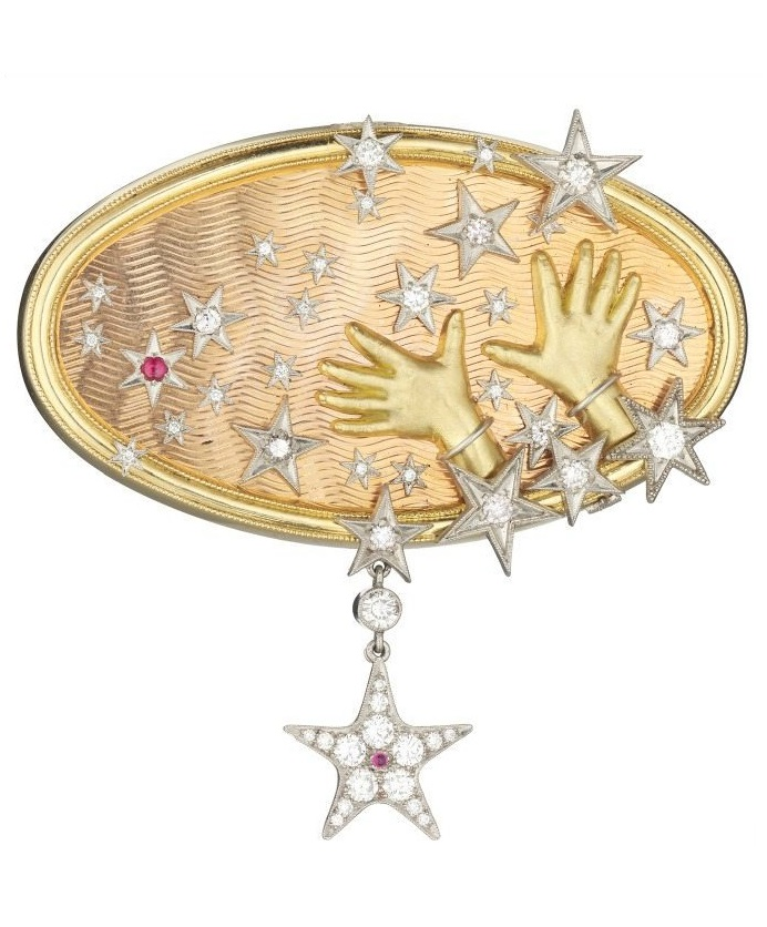 Reach for the Stars brooch by Anthony Lent, in gold with diamonds and rubies.