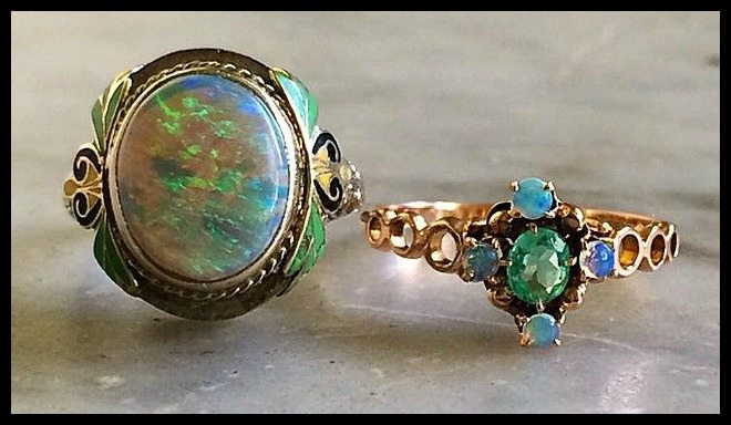 Two antique opal rings, one with enamel and one with an emerald.