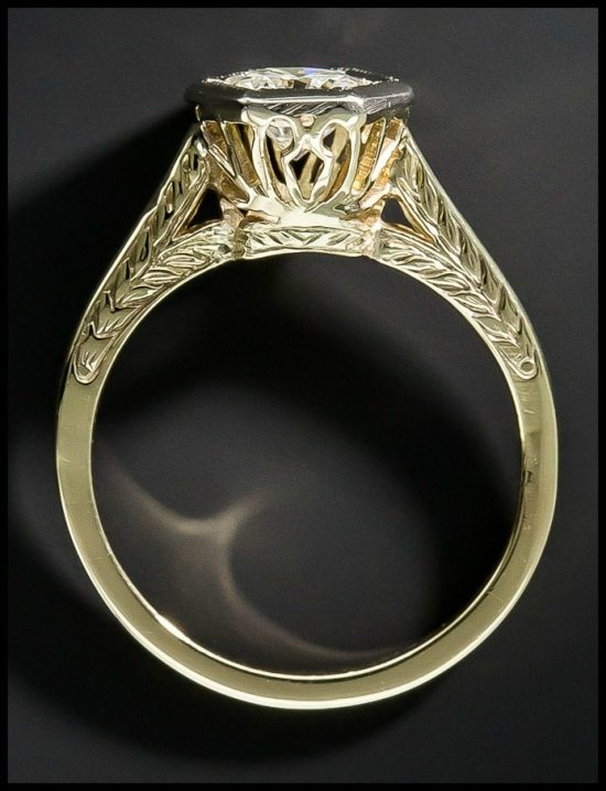 White and yellow gold filigree engagement ring; antique Art Deco setting with a more modern round brilliant cut diamond.