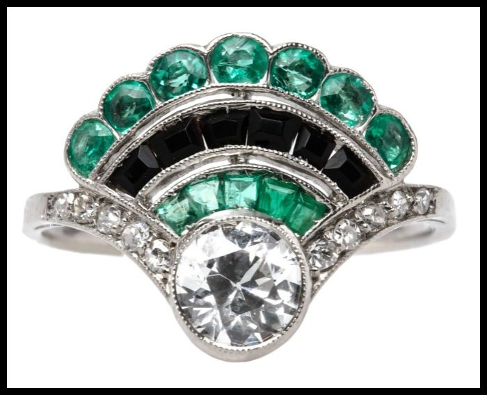 Antique Art Deco fan ring with diamonds, emeralds, and onyx.