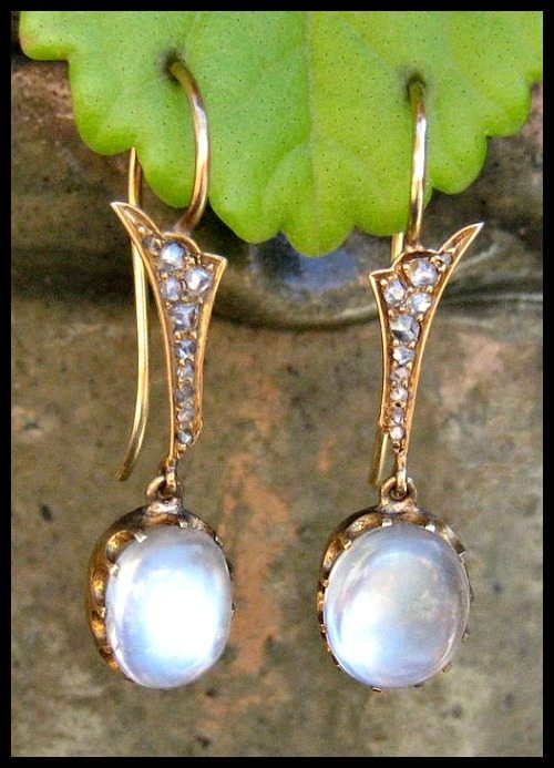 Antique Victorian moonstone and diamond earrings in gold.