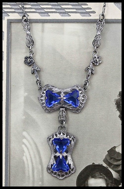 Art Deco sterling silver filigree, marcasite, and cornflower blue glass necklace.