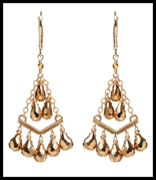 Dana Kellin golden chandelier earrings.